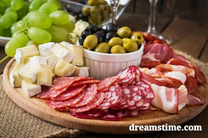 antipasto-catering-platter-bacon-jerky-salami-cheese-grapes-wooden-background-58150828_mh1526769465921